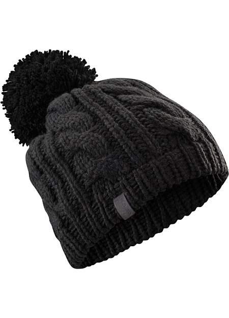 Cable Pom Pom Hat Heavy weight wool/acrylic yarns create a warm, chunky cable knit hat with large pom pom.