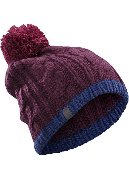 Heavy weight wool/acrylic yarns create a warm, chunky cable knit hat with large pom pom.