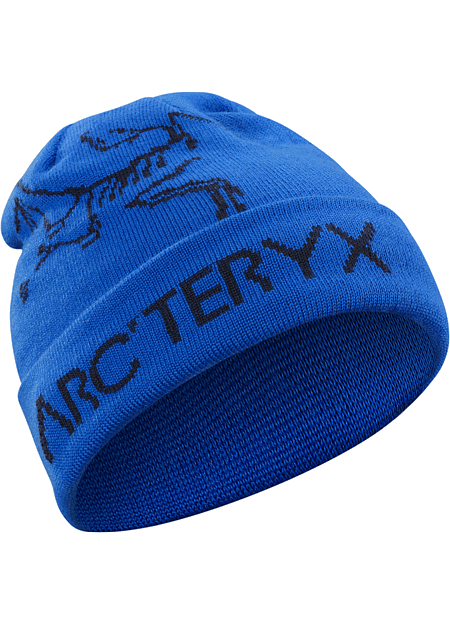 A warm, reversible winter hat featuring bold Arc'teryx graphics on one side, solid color on the other.